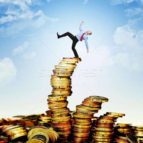 Inestable financiar trabajador caída euros moneda Foto stock © tiero
