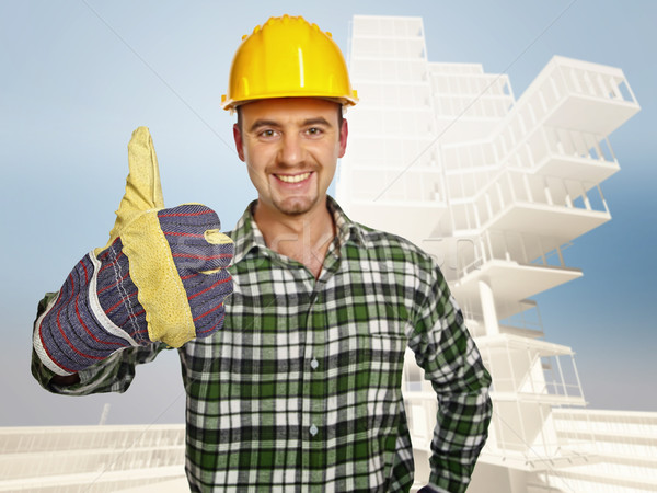smiling handyman and building background Stock photo © tiero