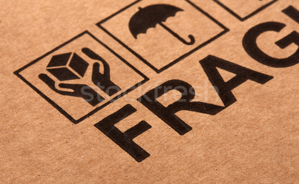 fine image close up of fragile symbol on cardboard Stock photo © tiero
