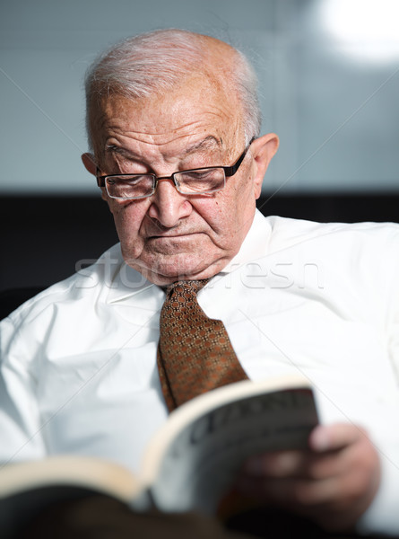 old man reading a book Stock photo © tiero