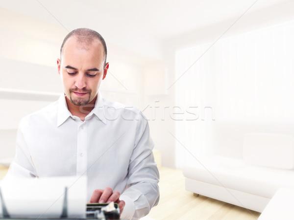 man with typewriter at home Stock photo © tiero