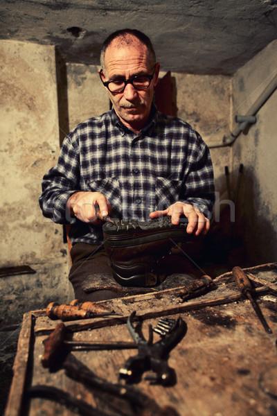 cobbler at work Stock photo © tiero