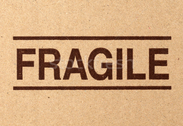 fragile symbol on cardboard Stock photo © tiero