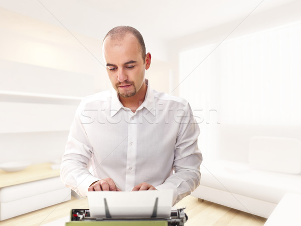 man with typewriter at home Stock photo © tiero