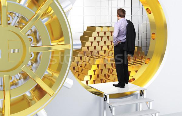 Arany álom férfi agykoponya rácsok pénz Stock fotó © tiero