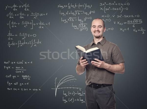 Matemática professor retrato jovem sorridente livro Foto stock © tiero