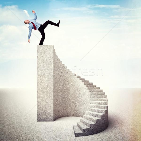 Spadek górę człowiek schodów w dół biznesmen Zdjęcia stock © tiero