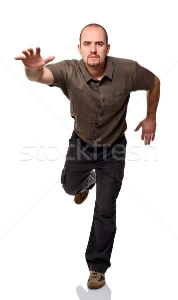 Esecuzione uomo eseguire posa isolato Foto d'archivio © tiero