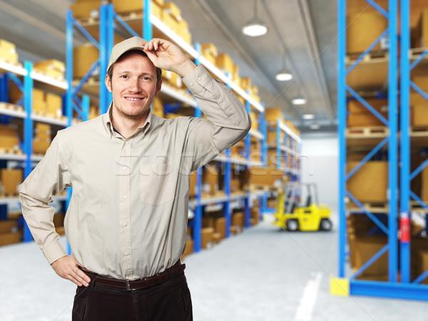 Sonriendo trabajador mensajero clásico almacén trabajo Foto stock © tiero