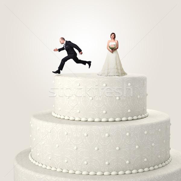 Menekülés esküvő ugrik felső torta szeretet Stock fotó © tiero