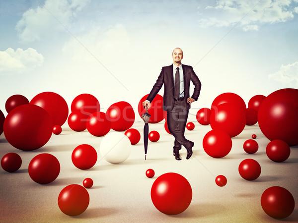 улыбаясь бизнесмен Постоянный человека красный сфере Сток-фото © tiero