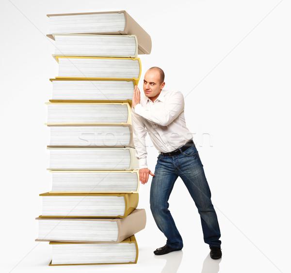 man push book pile Stock photo © tiero