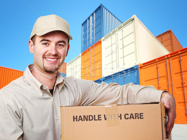 Stock photo: delivery man and colorful container