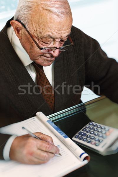 old man calculate his expenses Stock photo © tiero