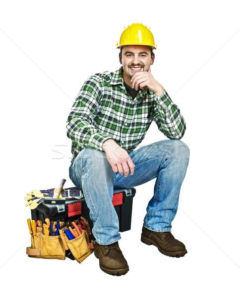 young handyman sit on toolbox Stock photo © tiero