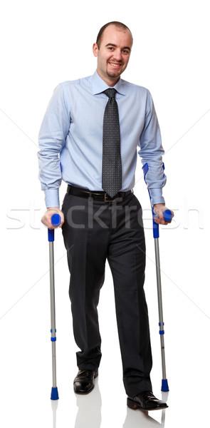 Hombre muleta aislado blanco sonrisa medicina Foto stock © tiero