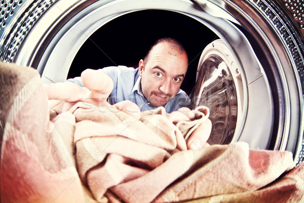 man and washing machine Stock photo © tiero