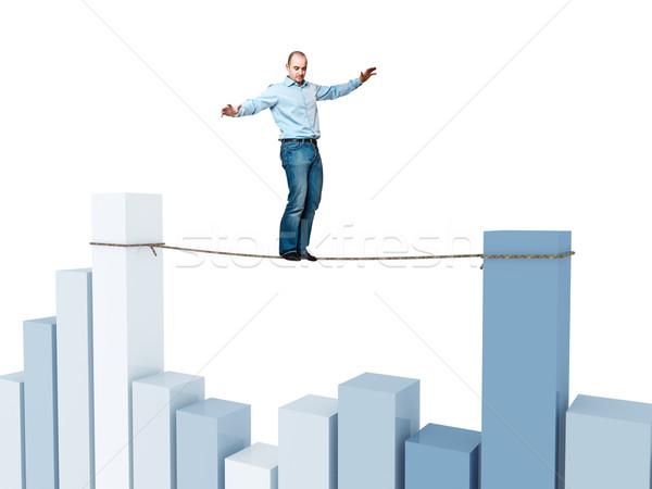 Pénzügyi akrobata férfi kötél egyensúly nő Stock fotó © tiero