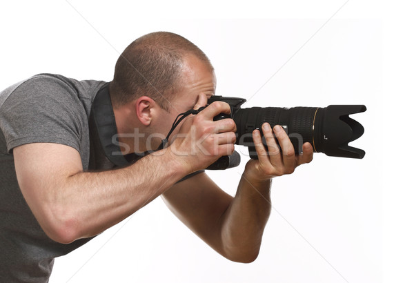 paparazzi photographer isolated on white Stock photo © tiero