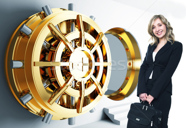 woman and bank vault Stock photo © tiero
