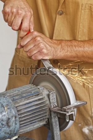 manual worker sharp his tool Stock photo © tiero