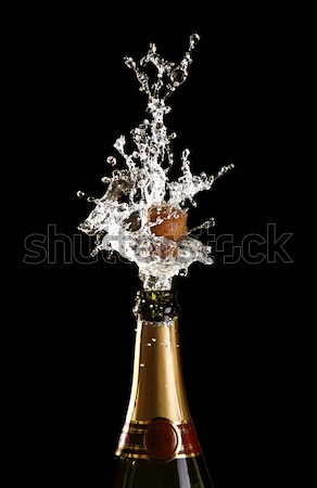champagne bottle with shotting cork Stock photo © tiero