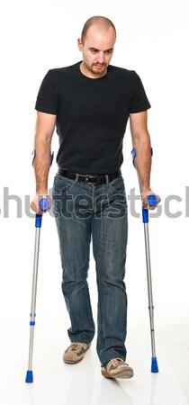 Férfi mankó fiatalember izolált fehér orvosi Stock fotó © tiero