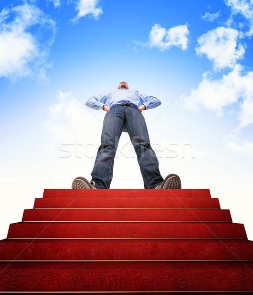 Escalier succès permanent homme tapis rouge nuages Photo stock © tiero