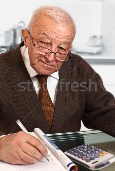 senior with calculator Stock photo © tiero