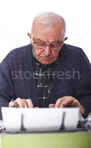 senior with typewriter Stock photo © tiero