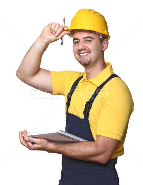 smiling handyman with notebook Stock photo © tiero