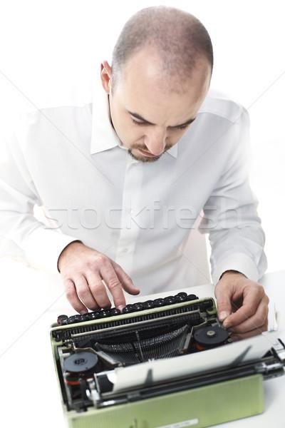 man with vintage typewriter Stock photo © tiero