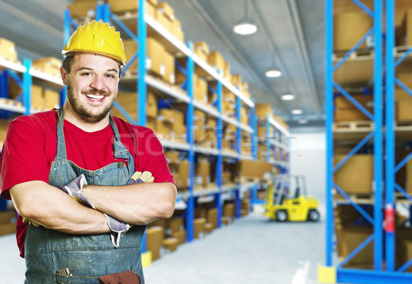 smiling worker in warehouse Stock photo © tiero