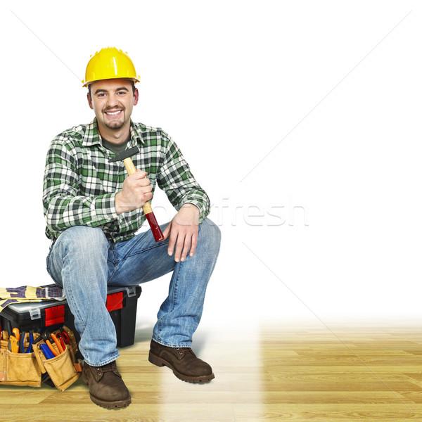 Klusjesman houten vloer jonge man tools hout Stockfoto © tiero