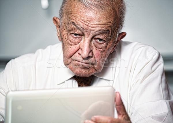 old man use pc Stock photo © tiero