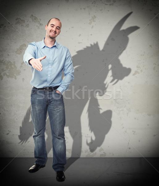 Zaufania mnie uśmiechnięty biznesmen wilk cień Zdjęcia stock © tiero