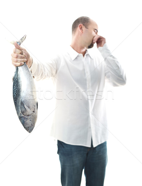 man with smelly fish Stock photo © tiero