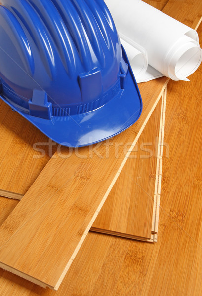 Stock photo: helmet and blueprint