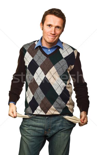 Nincs pénz fiatalember előadás üres zseb izolált Stock fotó © tiero