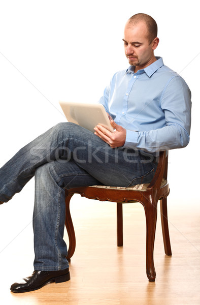 Adam oturmak sandalye genç işçi çalışmak Stok fotoğraf © tiero