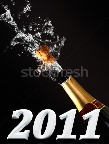 Champagne fles uitbarsting kurk 2011 tekst Stockfoto © tiero