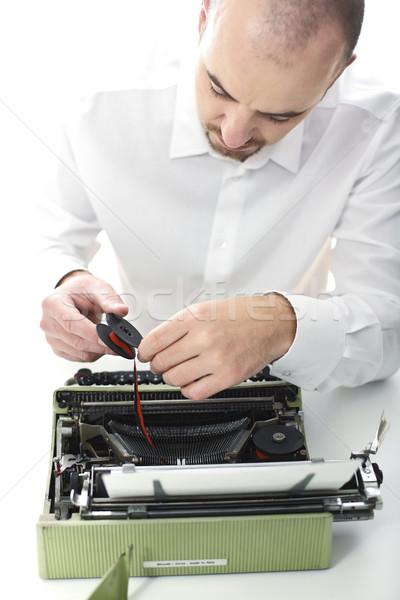 man fix vintage typewriter Stock photo © tiero
