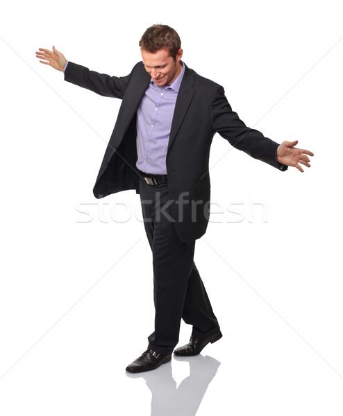 Business acrobaat man pose geïsoleerd witte Stockfoto © tiero
