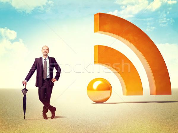 Rss działalności uśmiechnięty biznesmen 3D ogromny Zdjęcia stock © tiero