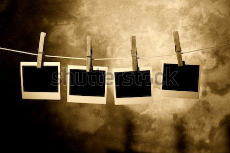 Stock photo: classic old polaroid photo Held By Clothespins