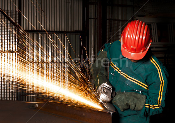 heavy industry manual worker with grinder Stock photo © tiero
