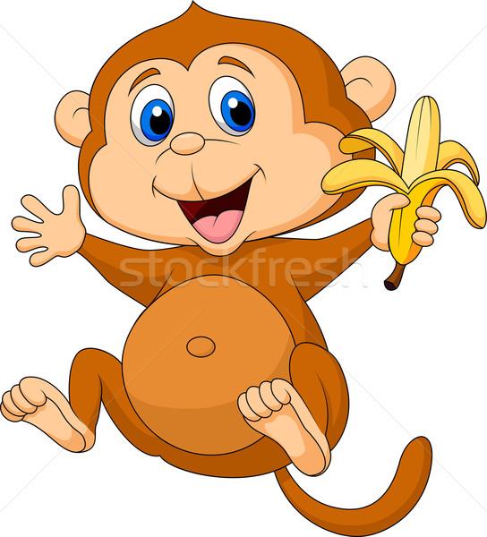 Cute scimmia mangiare banana bianco sorriso Foto d'archivio © tigatelu