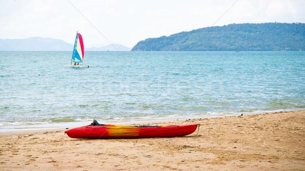 Sailing-boat and kayak Stock photo © timbrk