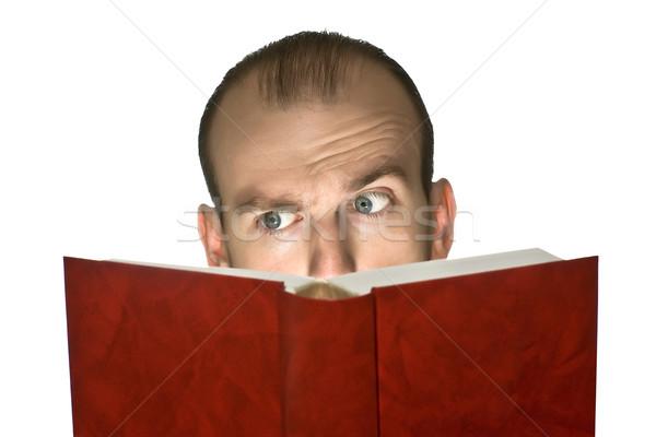 Sorpreso leggere uomo lettura libro isolato Foto d'archivio © timbrk