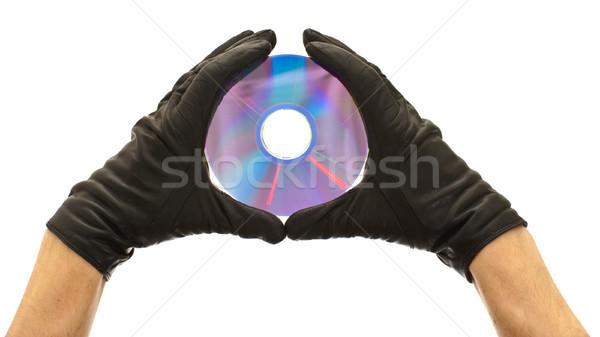 диск рук черные перчатки компакт-диск изолированный Сток-фото © timbrk